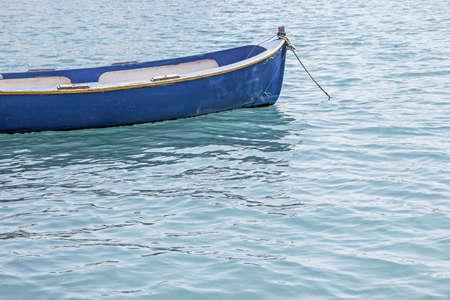 small boat floating in ocean