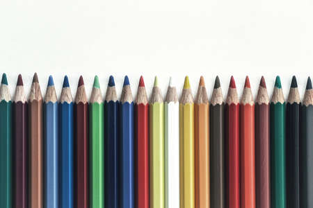 a pile of colorful pencils with white background
