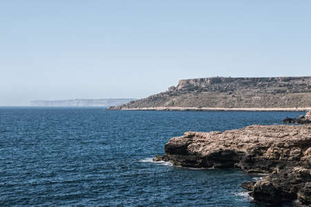 peaceful ocean with cliff in malta