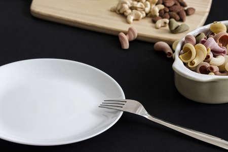salad with empty dish on dark background Reklamní fotografie