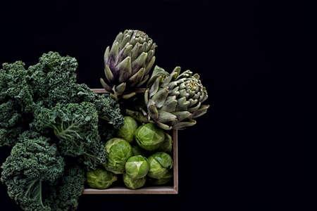 fresh green vegetables in box in dark