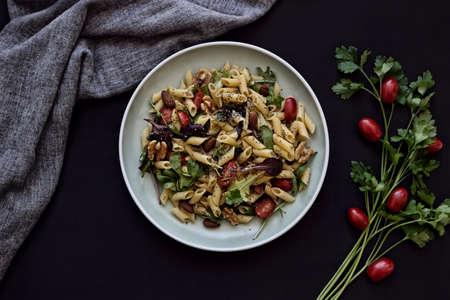 pasta salad dish on dark background