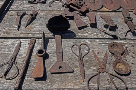 Rusty tools on wooden table