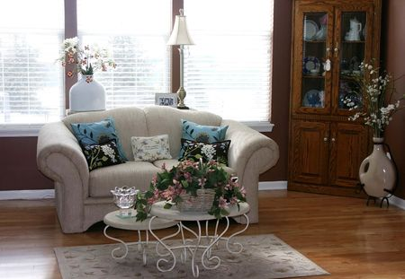 Pretty living room with a china cabinet and white couch Stock Photo