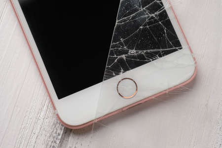 close up photo of an smart phone with broken protective glass