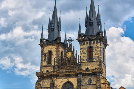 Church of our Lady before Tyn Prague - Architectural image in Old Town Square, in Prague, Czech Republic with Chram Matky Bozi pred Tynem with partly cloudy sky