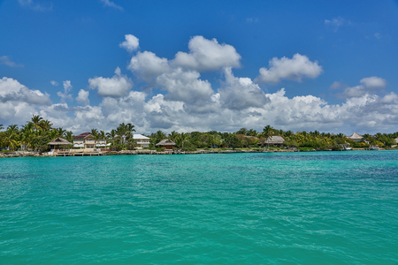 Tropical villas and bungalows as seen from the turquoise ocean typical Caribbean Island life Stock Photo