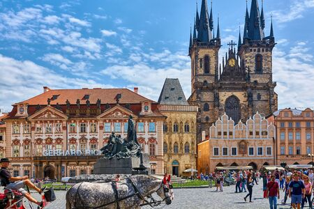 PRAGUE, CZECH REPUBLIC - JUNE 12 2017: Church of our Lady before Tyn Prague - Architectural image in Old Town Square in Prague, Czech Republic as seen on June 12, 2017, with tourists, horse carriage and other touristic objectives