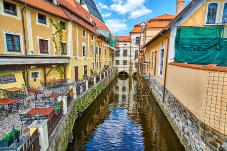 PRAGUE, CZECH REPUBLIC - JUNE 13 2017: A canal off the Vltava river with old architecture and quaint restaurant as seen on June 8, 2017