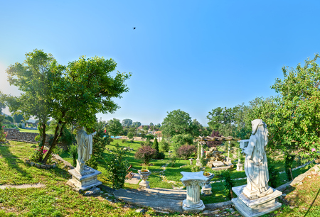 180 degrees panorama view of a rustic courtyard with statue replicas in Transylvania, Romania, copy space available over sky 版權商用圖片