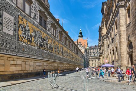 DRESDEN, GERMANY, JUNE 11 2017: The Furstenzug, long, dramatic mural made of Meissen porcelain tiles depicting Saxon rulers throughout the ages as seen on June 11, 2017