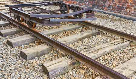 Old rusty delapidated railroad cart on a track