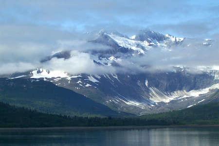 Alaskan mountain scene as viewed from inside passage cruise ship Stock Photo