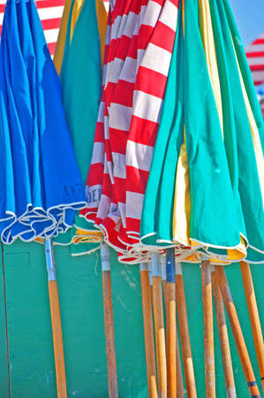 colorful beach umbrellas closed and stacked