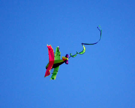 multi-colored kite against cloudless blue sky Stock Photo
