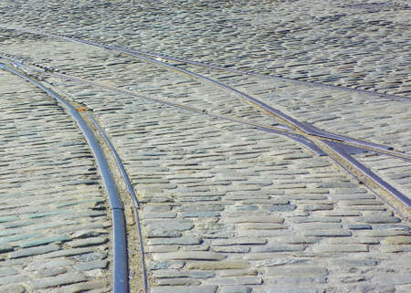 streetcar: Streetcar tracks on cobblestone street in Baltimore Stock Photo