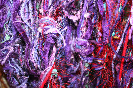 close knit: Purple yarns or threads for texture or background