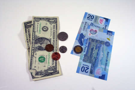 US dollars and Mexican pesos Stock Photo - 8079927