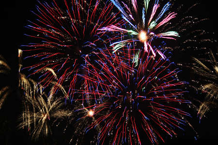 Colorful fireworks set off in night sky celebrating holiday