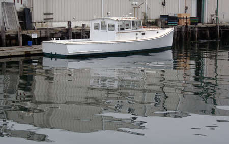lobster boat: White lobster boat in Portland Maine harbor Stock Photo