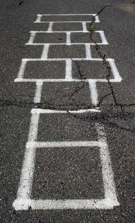 Hop scotch game on school playground asphalt photo