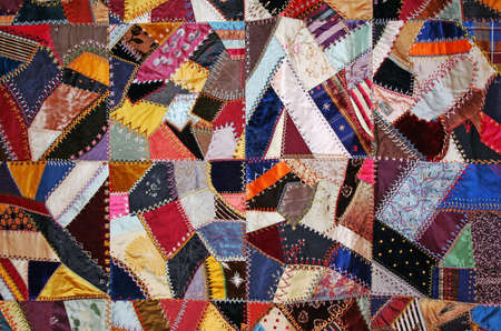patchwork quilt: Antique quilt colorful with stitching of patchwork for background Stock Photo