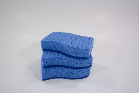 Spring cleaning 3 sponges stacked on white isolated