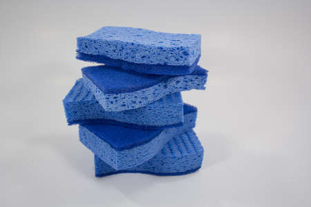 Spring cleaning 5 sponges stacked isolated on white Standard-Bild