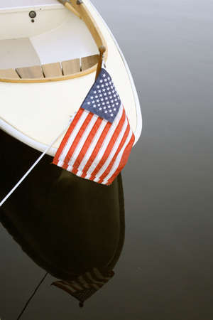 Bow of boat in harbor with US flag Standard-Bild