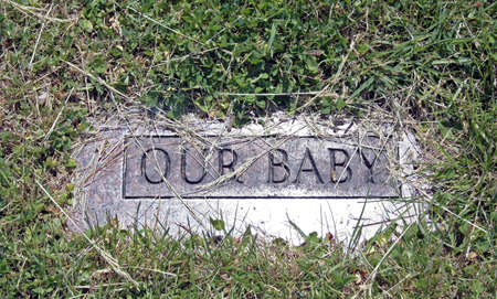 Stone grave marker of a baby