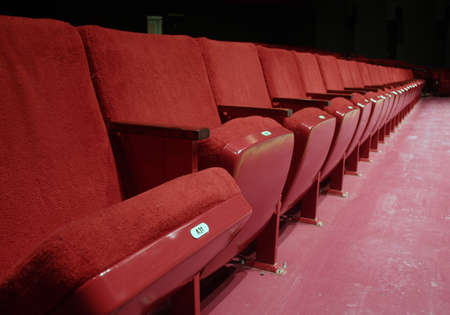 Red theater seats in small theater front row photo
