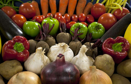 Fresh vegetables spread out for display photo