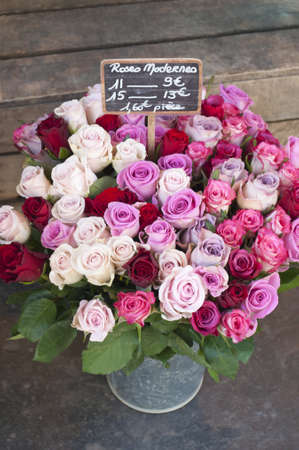 Pink, red and white roses for sale at a street market photo