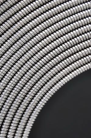 elasticity: Curve of flexible metal conduit represent strength and elasticity