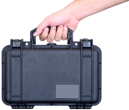 watertight: Hand is holding a black watertight suitcase Stock Photo