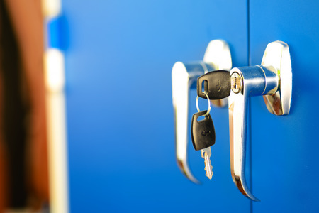 office cabinet: Side view with DOF of office cabinet door locker with metallic handle. Stock Photo
