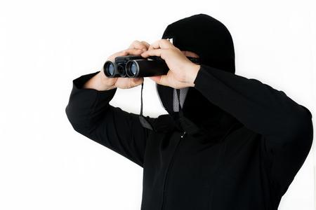 hijack: Man in black jacket looking through spyglass