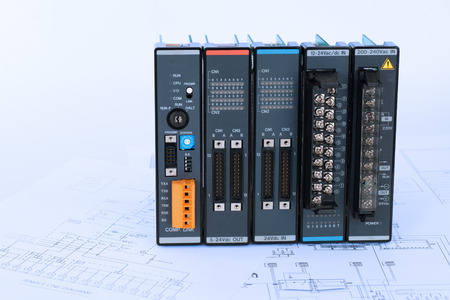 Isolated industrial PLC modules place on process control diagram blueprint