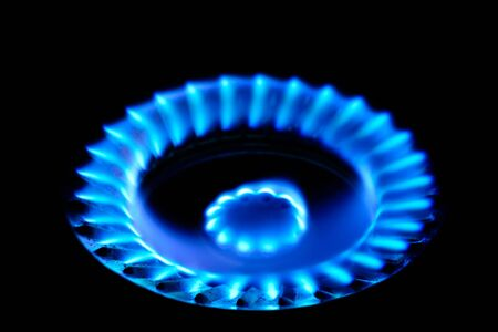 butane: Closeup blue color of flame of fire from gas stove in dark background