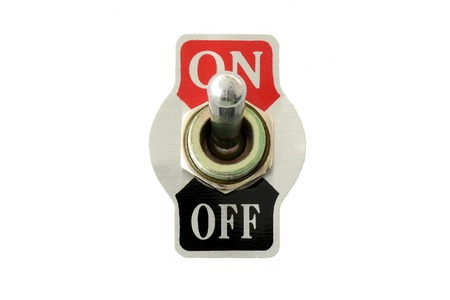 Front view closeup of toggle switch for electric circuit on-off, isolated in white background
