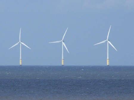 wind turbines in irish sea off welsh coast. Stock Photo - 1729854