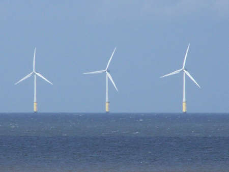 windy energy: wind turbines in irish sea off welsh coast.