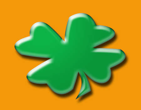 Irish shamrock on orange background   photo