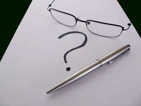 Glasses with pen and question mark on white blank paper Wtriters Black