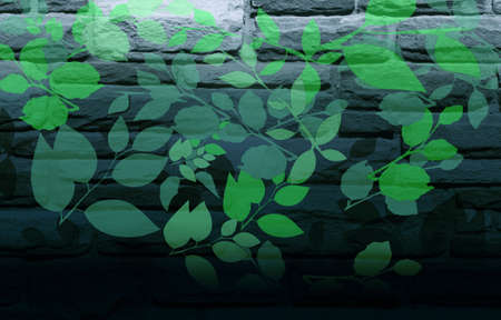 preservation: Green Leaves Painted on Blue-Grey Brick Wall