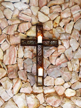 easter candle is burning: Picture of Mounted Christian Cross with White Candles