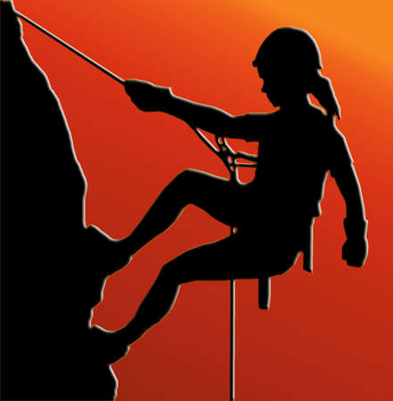 Sunset Back Isolated Image of a Female Abseiler Climbing a Rock Face photo