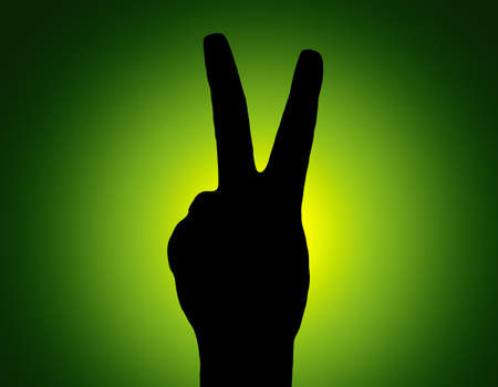 Silhouette Piece Hand on Green Colored Background photo