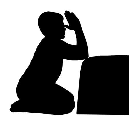 child praying: Kneeling Child Praying next to his Bed