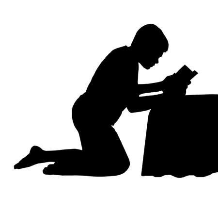 kneeling: Kneeling Child Reading his Bible next to his Bed